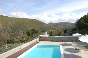 A view of the pool at Quinta dos Castanheiros - Turismo Rural or nearby