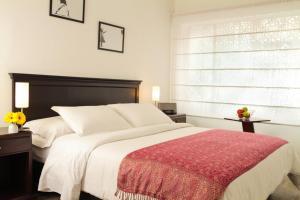 Кровать или кровати в номере Matisse Hotel