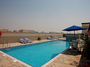 The swimming pool at or near Rose Garden Hotel Apartments - Barsha