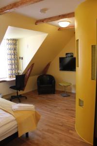 En tv och/eller ett underhållningssystem på Magles Smiley Inn