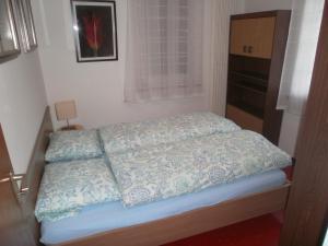 Ein Bett oder Betten in einem Zimmer der Unterkunft Appartamento Posmonte