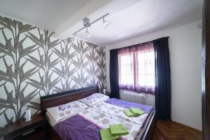 Ein Bett oder Betten in einem Zimmer der Unterkunft Apartments Old Town Square 27