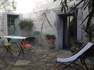 A porch or other outdoor area at Chambre d'hôtes Les Bienvenus