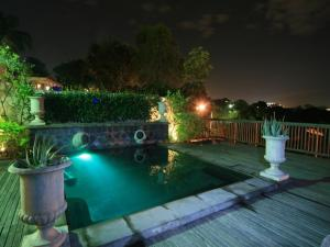The swimming pool at or near Lembali Lodge Luxury Guesthouse