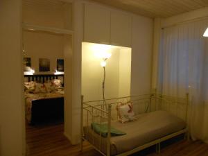 Vuode tai vuoteita majoituspaikassa Anne's City Apartment