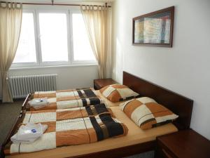A bed or beds in a room at Hotelový dům Areál