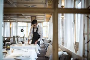 Een restaurant of ander eetgelegenheid bij Rosa Alpina Hotel & Spa