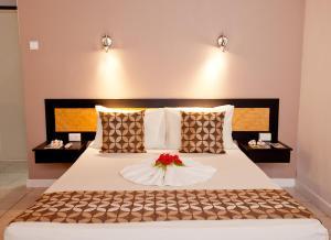 Кровать или кровати в номере Gecko's Resort