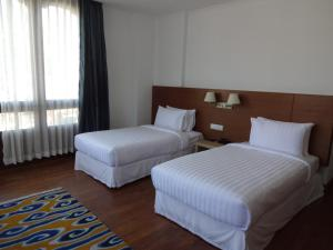 A bed or beds in a room at Osel Thimphu Bhutan