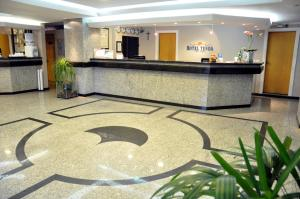O saguão ou recepção de Hotel Tenda