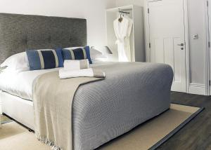 A bed or beds in a room at Brocco On The Park Boutique Hotel