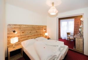 Ein Bett oder Betten in einem Zimmer der Unterkunft Panorama Landhaus