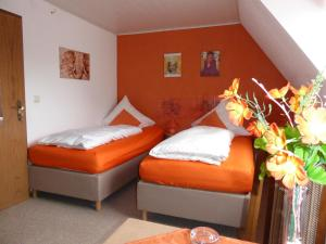 A bed or beds in a room at An der Uferpromenade
