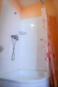 Ванная комната в Hotel Uyut