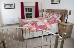 A bed or beds in a room at Ardagh Suites Self Catering