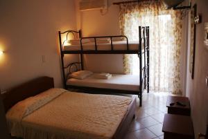 Μία ή περισσότερες κουκέτες σε δωμάτιο στο Villa Iris