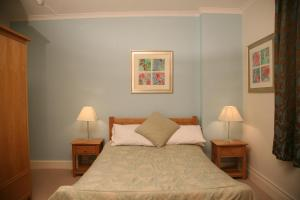 A bed or beds in a room at Tamasha Hotel