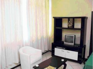 A television and/or entertainment center at Manga Rosa Suites