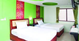 A bed or beds in a room at Krabi Orchid Hometel
