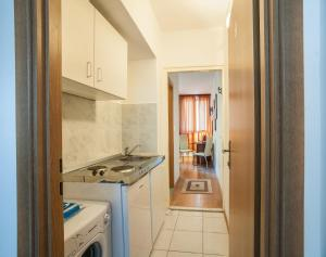 A kitchen or kitchenette at Sweet Dreams Apartments