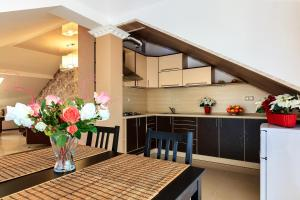 Кухня или мини-кухня в Гостевой Дом Даллас