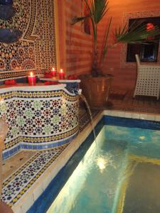 The swimming pool at or near Riad Dar Sissel