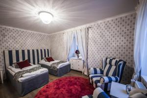 Кровать или кровати в номере Mukkulan Kartano