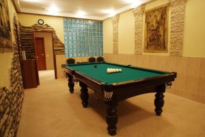 A billiards table at Grin Hotel