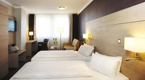 A bed or beds in a room at Stern Hotel Soller