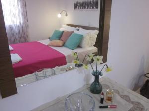 Кровать или кровати в номере Petra Houses