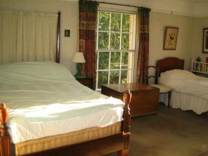 A bed or beds in a room at Bulmer Tye House