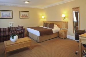 A bed or beds in a room at Grange Buckingham Hotel