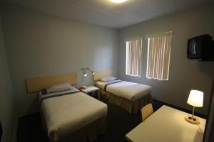 Cama ou camas em um quarto em Leamington Hotel - Downtown / Port of Miami