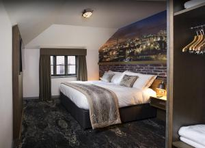 A bed or beds in a room at Abel Heywood Boutique Hotel