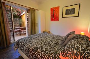 A bed or beds in a room at Vatu Sanctuary