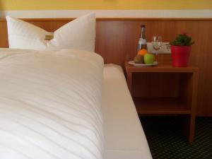 Ein Bett oder Betten in einem Zimmer der Unterkunft Hotel & Restaurant Engel