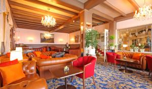 The lounge or bar area at Eiger Mürren Swiss Quality Hotel