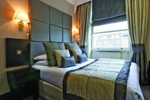 Säng eller sängar i ett rum på Grange White Hall Hotel