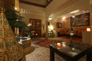 The lounge or bar area at Riad Andalla