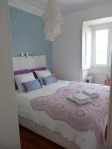 A bed or beds in a room at Sete Colinas Apartment by Altido