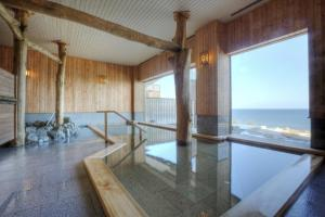The swimming pool at or near Kokorono Resort Umino Bettei Furukawa