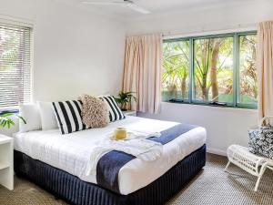 A bed or beds in a room at Pinetrees Lodge