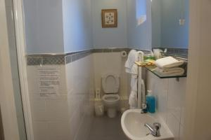 A bathroom at Athena Guest House