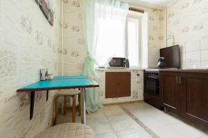 A kitchen or kitchenette at Likhachevskoye Sheremetyevo Apartment