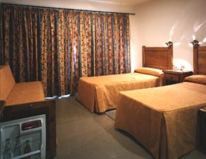 Кровать или кровати в номере El Molino de La Torre