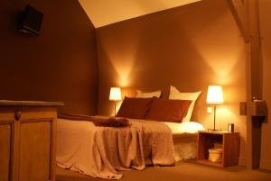 Un ou plusieurs lits dans un hébergement de l'établissement Maison d'hôtes Villa Richelieu