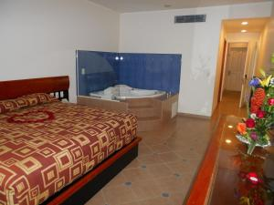 A bed or beds in a room at GS Cuernavaca