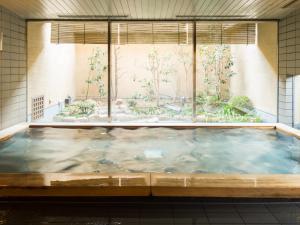 The swimming pool at or near Mitsui Garden Hotel Okayama