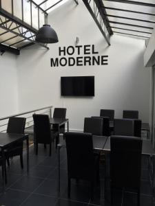 The business area and/or conference room at Hôtel Moderne