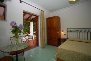 Patio o area all'aperto di Residence Hotel Villa Fiorentino